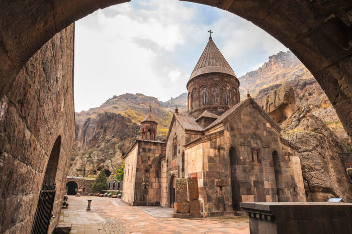 Geghardavank or Geghard monastery is an Orthodox Christian monastery located in Kotayk Province of Armenia Ancient Ancient Civilization Arch Architecture Armenia Building Exterior Built Structure Christianity Cloud - Sky Day Famous Place History Indoors  Monastery Mountain Nature No People Old Ruin Orthodox Church Place Of Worship Religion Sky Spirituality Sunlight Travel Destinations