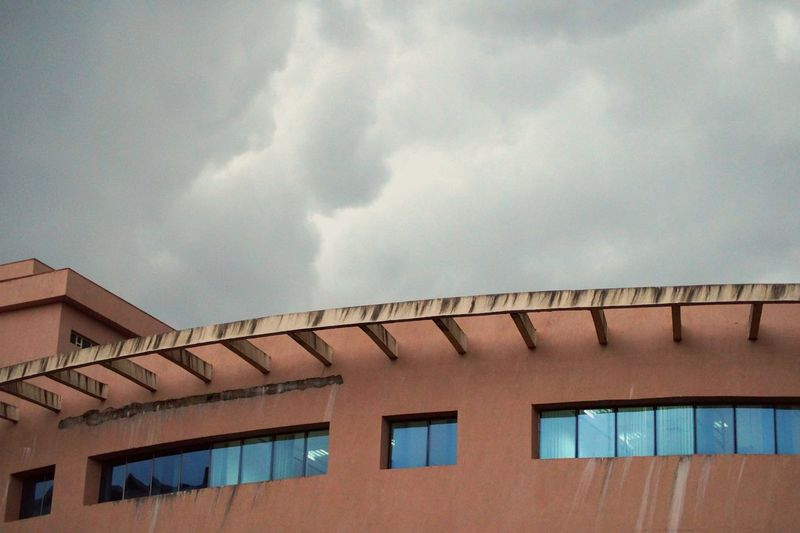 Architectural Feature Architecture Building Building Exterior Built Structure Cloud Cloud - Sky Cloudy Day High Section Low Angle View Manipal Manipal Intitute Of Technology Nature No People Outdoors Overcast Residential Building Residential Structure Roof Sky Weather