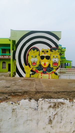 Painting At Wall Of A Hotel Beside Sea