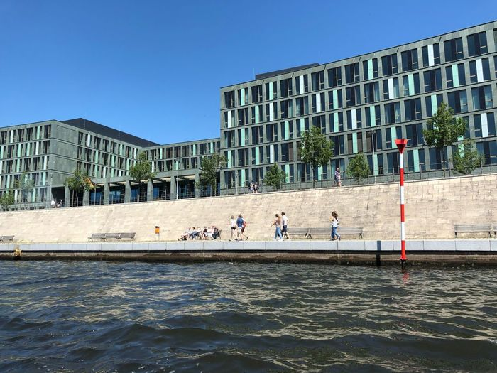 Spree River Berlin Berlin IPhone X Photography IPhone X Blue Sky Built Structure Building Exterior Architecture Group Of People Sky Clear Sky Day Nature Sunlight City Real People Large Group Of People Building Outdoors Men Blue Crowd Water Women