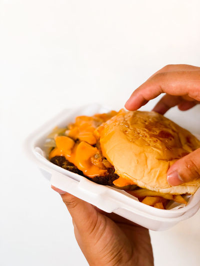 Close-up of person holding food