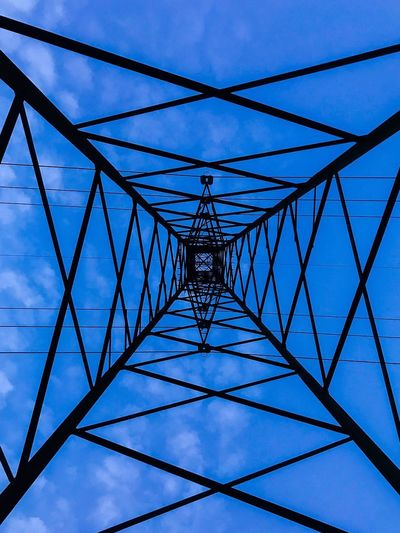 Cable Power Supply Connection Electricity  Power Line  Fuel And Power Generation Low Angle View Complexity No People Electricity Pylon Outdoors Sky Blue Day