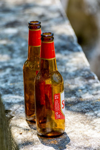Close-up of beer bottle on table