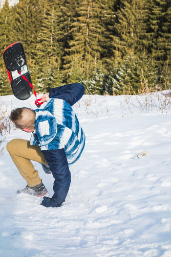 Falling is a part of learning Snow Winter Cold Temperature Warm Clothing Land One Person Real People Lifestyles Leisure Activity Field Day Nature Outdoors Snowcapped Mountain Slope Fall Falling In Motion Pine Tree Slide Board Board Slide Snowboarding Tumble Sunny