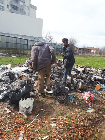 Only Men Adults Only Adult People Mature Adult Day Full Length Two People Outdoors Togetherness Sky Men Working Headwear Young Adult Volunteer Garbage Real People Built Structure Waste Management Standing Building Exterior Architecture End Plastic Pollution