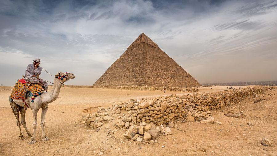 Man riding horse in a desert