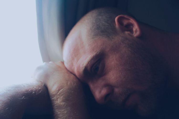 Close-up of sad man