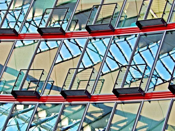 Built Structure Architecture Low Angle View Glass - Material No People Building Exterior Pattern Day Window Building Outdoors Full Frame Reflection Multi Colored Office Building Exterior Backgrounds Modern Steel And Glass