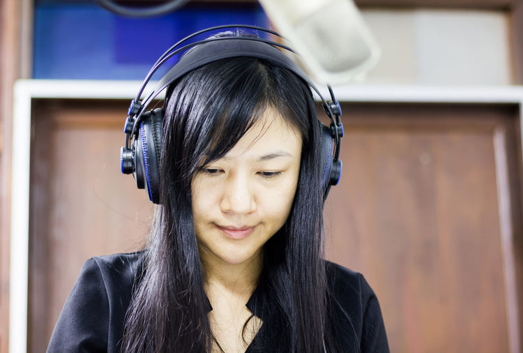 Close-up of radio presenter wearing headphones