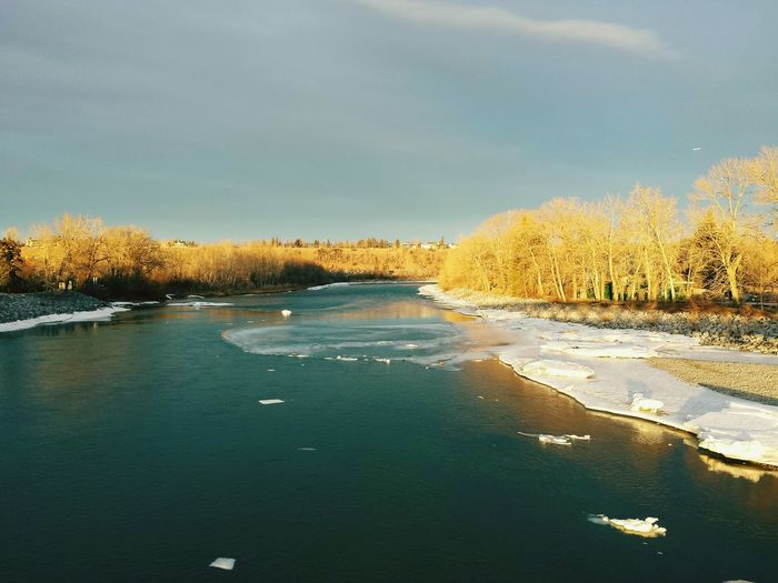 High angle view of frozen river against sky