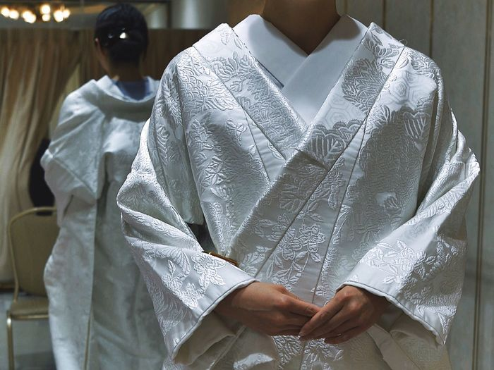 Bride wearing traditional kimono reflecting in mirror