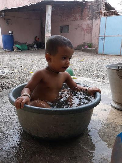 Cute Boy Sitting In Tub