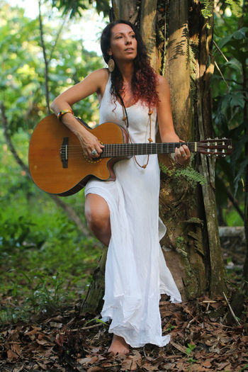 Valentina Beauty In Nature Forest Guitar Music Music Nature Singer  Tree Tropical White Into The Woods Beauty Uniqueness