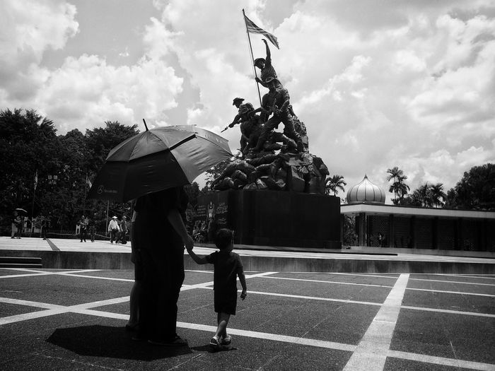 """Tugu Negara"" Malaysia War Memorial Monument Monument War Memorial Tree City Statue Sky Umbrella Rainy Season Under Visiting Politics And Government Raincoat Puddle Rainfall Parliament Building Government Sculpture The Still Life Photographer - 2018 EyeEm Awards"