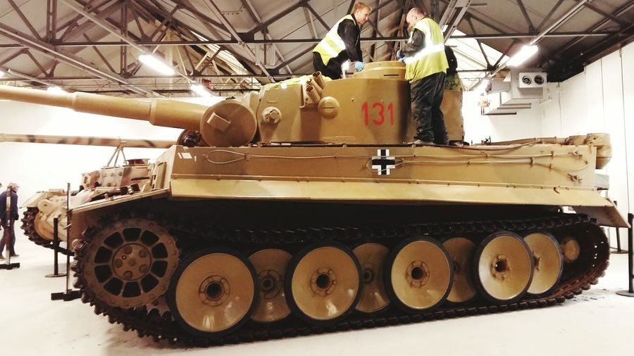A picture of a German Tiger Tank Inside the Tank Museum . Featuring Industry Business Finance And Industry Working Occupation People Indoors  United Kingdom World War Tank Daytime Museum Mode Of Transport Last Working Tiger Tank Military Last Working Close-up History History Coming To Life The Tank Featured In The Film Fury Film Star