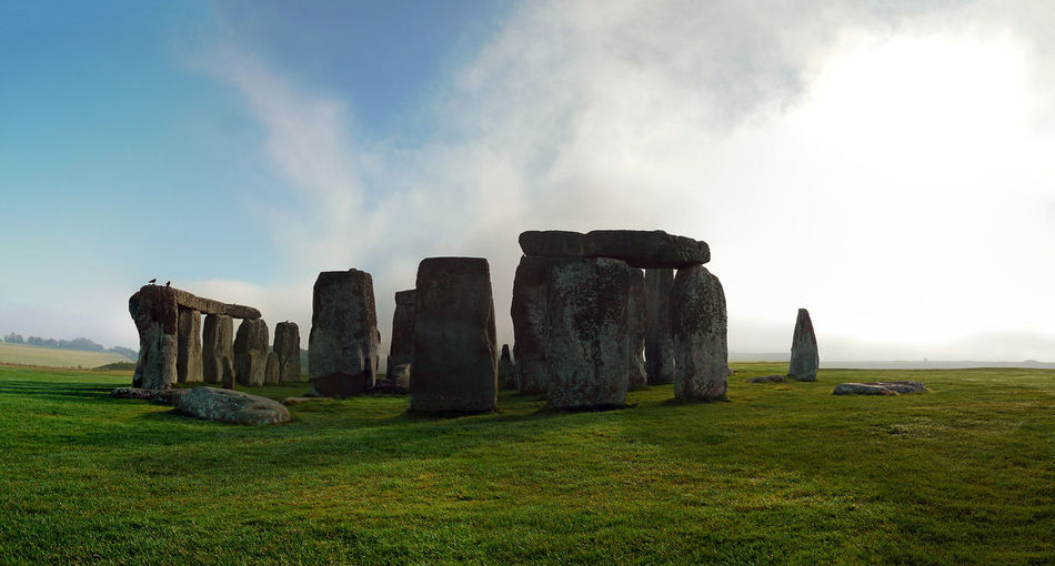Scenic view of stonehenge against sky