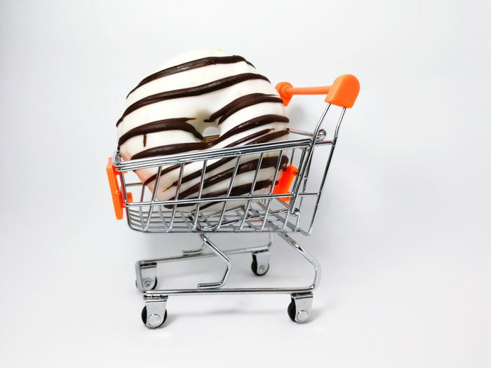 doughnut has been bitten in the trolley EyeEm Selects Shopping Cart Consumerism Retail  Buying Supermarket Customer  Shopping Basket Shopping Bag Store Groceries Business Market Studio Shot People Food Indoors  Stock Market And Exchange One Person Close-up Food Stories