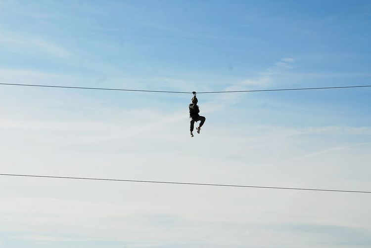Low Angle View Of Man On Tyrolean Rope