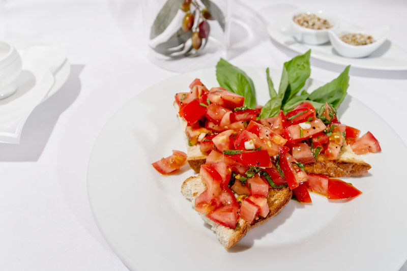 Bruscetta Tafel Haute Cuisine Appetizer Basil Bruscetta Close-up Day Food Food And Drink Freshness Healthy Eating High Angle View Indoors  Indulgence Italian Food Leaf No People Plate Ready-to-eat Serving Size SLICE Still Life Table Tomato Tomatoes Vegetable