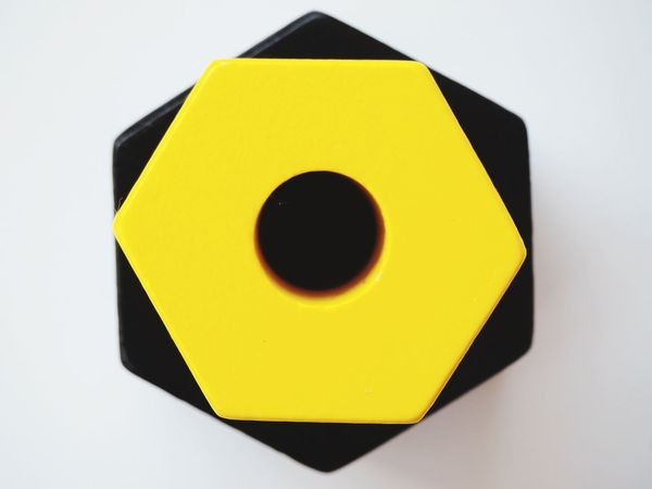 White Background Yellow On Top Of Each Other Hexagonstyle Black And Yellow  Hexagon Circles And Holes Black Hole Colored Wood Neon Life EyeEmNewHere Multi Colored Geometry Pattern Geometric Abstraction Abstract Geometric Shape Geometry Minimalist Photography  Minimalism Abstract Photography Wooden Shapes Geometric Background Gears Paint The Town Yellow