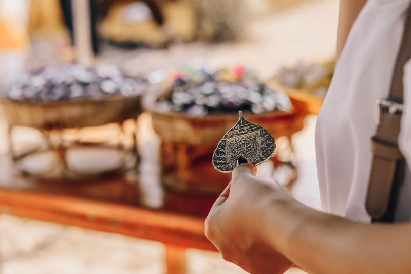 Midsection of woman holding religious equipment