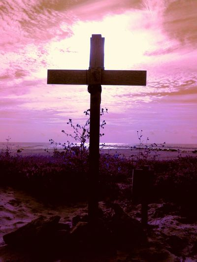 I stand behind this Cross over looking the dunes, Praying to my Good Lord