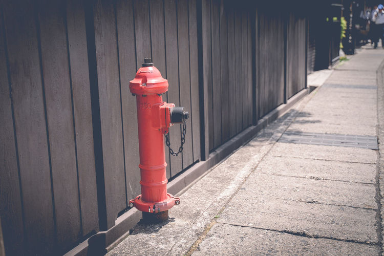 Red fire hose in the city to watch for fire time.