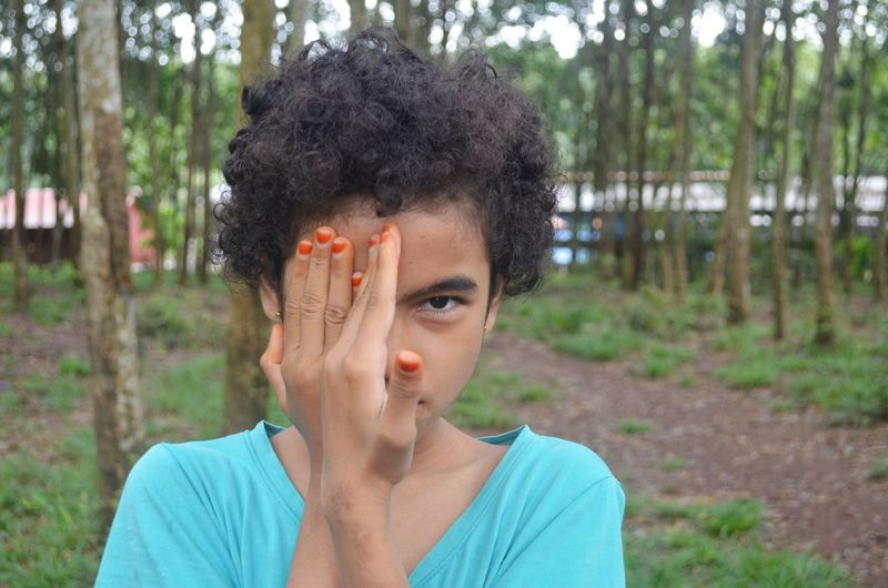 Portrait Of Girl Hiding Face With Hands