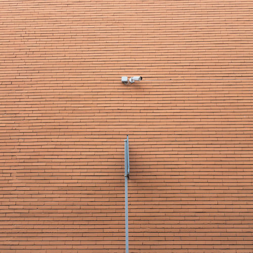 Brick Wall Camera Brick Brown Cctv Day No People Outdoors Pattern Road Sign Surveillance Symmetry