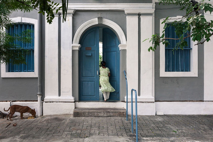 Arch Architecture Building Building Exterior Built Structure Day Dog Door Doorway Entrance Façade Grey Home House India Marji Lang Photography Open Pondicherry Residential Structure Street Photography Travel Photography White Window Woman