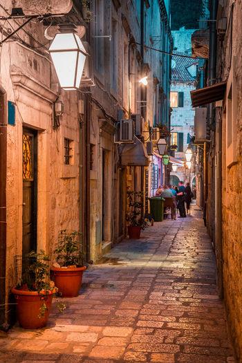 Narrow street between buildings in town