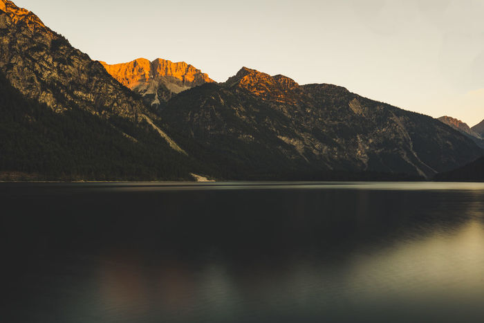 Sunrise over the mountains. Mountains reflection in the lake. Beauty In Nature Clear Sky Day Formation Idyllic Lake Mountain Mountain Peak Mountain Range Nature No People Non-urban Scene Outdoors Reflection Rock Scenics - Nature Sky Tranquil Scene Tranquility Water Waterfront