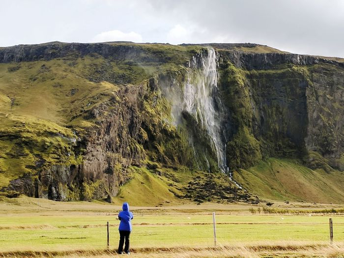 Waterfall Cliff Wind Weather Icelandic Landscape Full Length Rear View Motion Standing Sky Landscape Physical Geography Rugged Natural Landmark