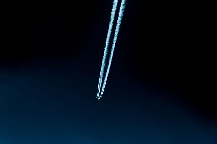 Blue Flying No People Sky Cloud - Sky Vapor Trail Studio Shot Air Vehicle Airplane Single Object Black Background Copy Space Indoors  Smoke - Physical Structure Mid-air Close-up White Color Nature Simplicity Night Softness Plane