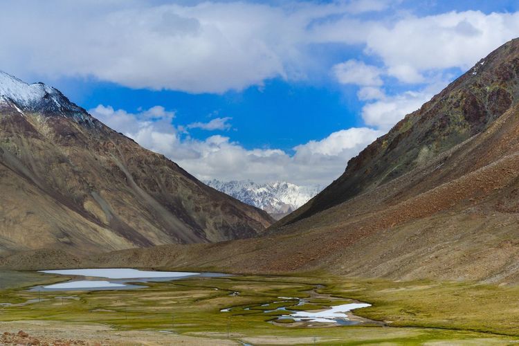 Scenic view of mountains against cloudy sky at leh ladakh
