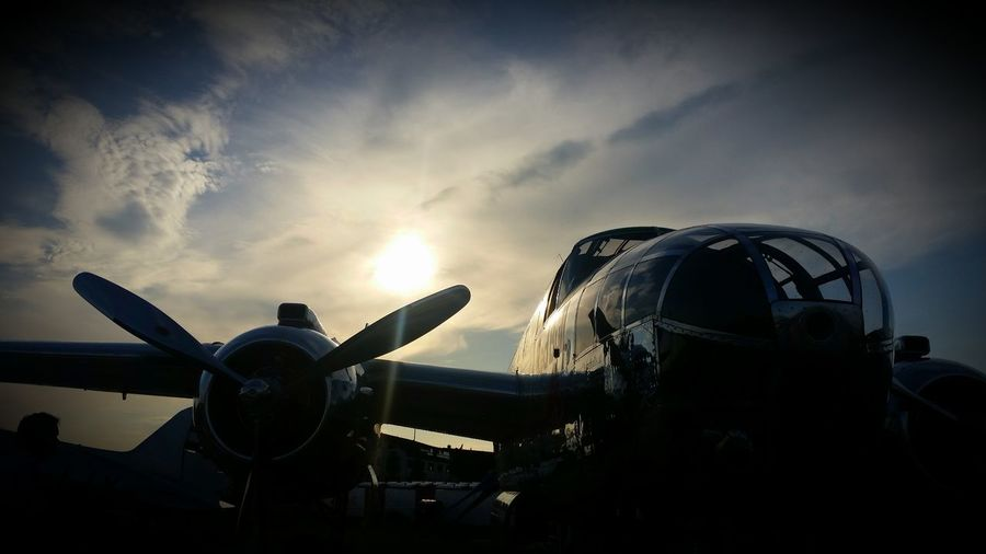 Low angle view of airplanes against the sky