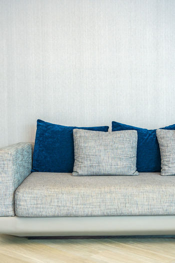 Close-up of sofa against wall at home