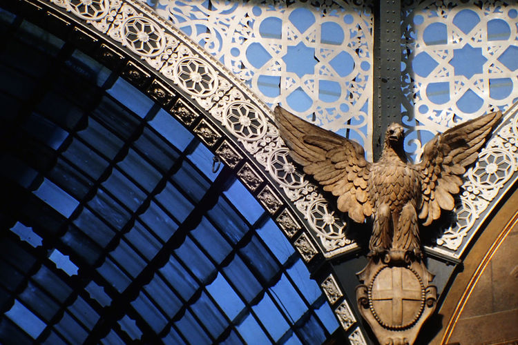 Low Angle View Of Bird Statue At Galleria Vittorio Emanuele Ii