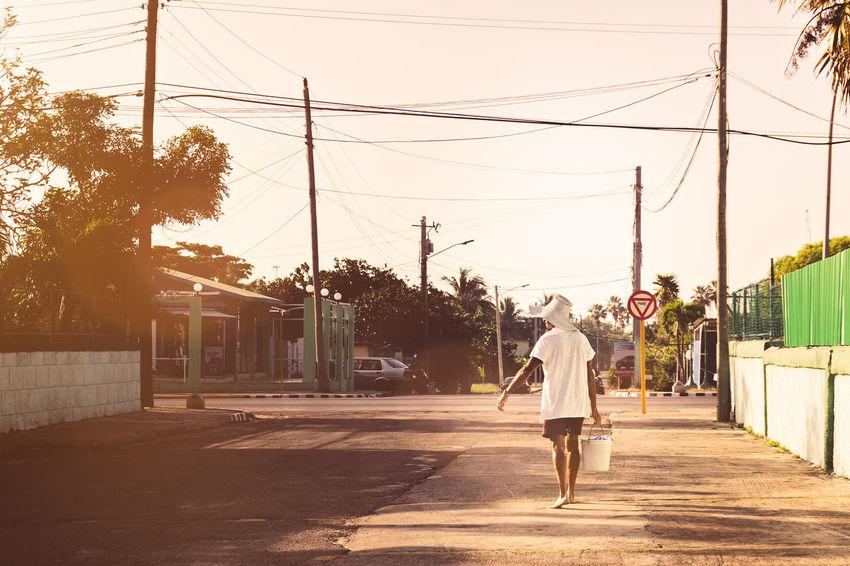 Cuba Day Enjoying The Sun Eye4photography  EyeEm Best Shots EyeEm Gallery Fisherman Full Length Lifestyles Light And Shadow Outdoors Rear View Road Street Street Photography Streetphotography Summer Sunlight Taking Photos The Way Forward Tree Urban Urbanlife Waling Around Walking