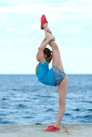 Acrobat Aerobics Athlete Caucasian Exercise Fitness Flexible Girl Gymnast  Ocean Outdoors Sea Sky Sport Sportive Stretch Teenager Water Young