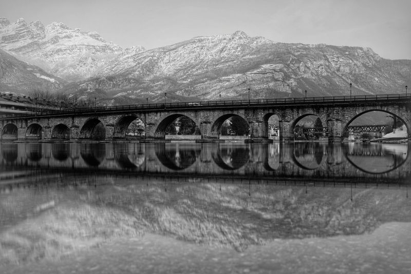 Ponte Vecchio di Lecco Bnw_friday_eyeemchallenge Pontevecchio Alphausers A7r2 35mm Fe35f28z Zeisslenses Sony Nd1000 Reflection Blackandwhite Photography Blackandwhite Lago Di Como, Italy Bnw_collection Blackandwhitesony Lucariva Bridge - Man Made Structure Connection Mountain Architecture Built Structure Sky Winter River Outdoors Snow Cold Temperature Nature Day No People