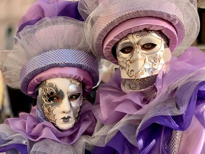 Close-up of people wearing masks and costumes
