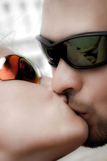 Kiss Love Body Part Close-up Fashion Glasses Headshot Human Body Part Kisses Lifestyles Portrait Real People Sunglasses Young Adult A New Beginning The Modern Professional Human Connection Moments Of Happiness Moms & Dads