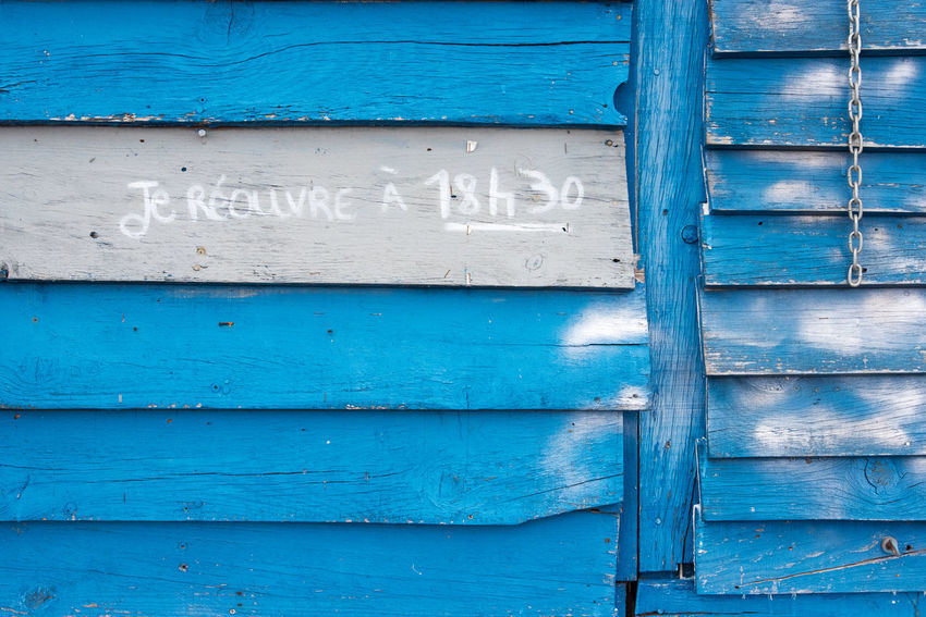 Blue Backgrounds Full Frame Wood - Material Text No People Door Entrance Communication Day Architecture Old Security Close-up Wall - Building Feature Safety Protection Textured  Closed Western Script Outdoors Turquoise Colored Hut Shop Chain Historic Written Closed Door Entry Information