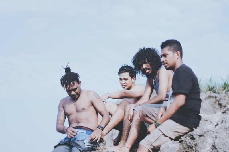 EyeEm Selects Sky Leisure Activity Togetherness Young Men Mid Adult Men Friendship Vacations Outdoors Smiling Men Beach Day Looking At Camera Happiness Shirtless Real People Lifestyles Portrait Young Adult