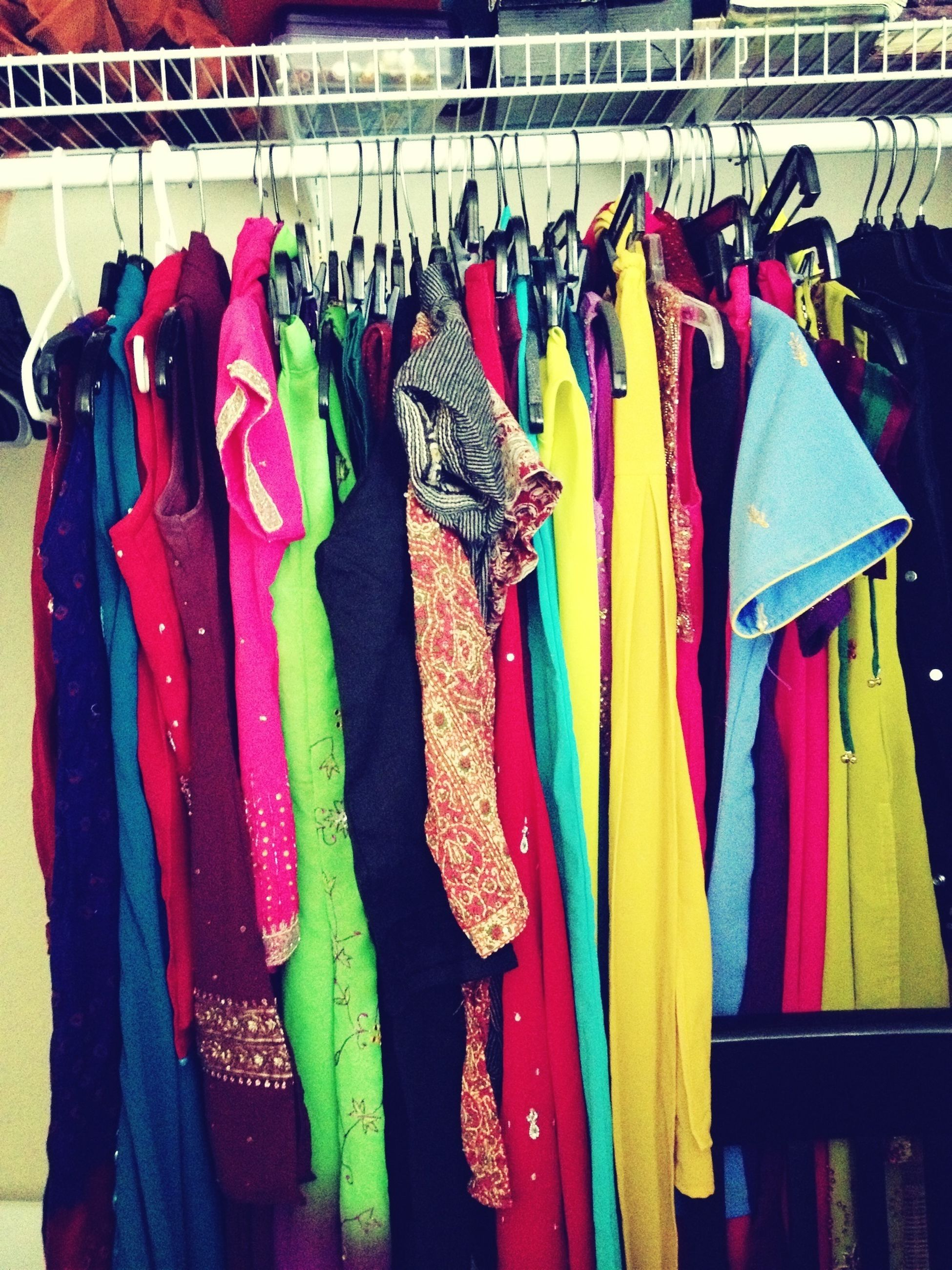 hanging, variation, for sale, choice, retail, market stall, clothing, multi colored, large group of objects, market, store, arrangement, sale, abundance, in a row, display, drying, collection, shop, indoors