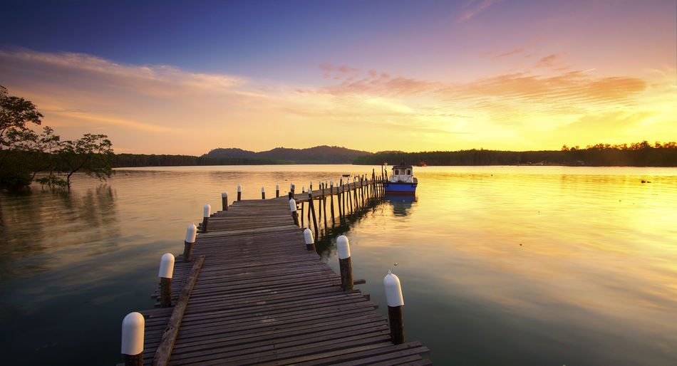 My Year My View Landscape Lake Water Outdoors Travel Nature No People In A Row Beauty In Nature Day Boat Jetty Tranquil Scene Scenics Sky Backgrounds Jetty Perspective Sunrise That's Me Orange Color Coastline Beautiful Sky And Clouds Sunset