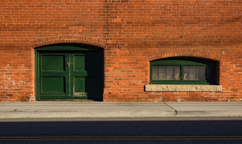 Arch Architecture Brick Wall Building Exterior Built Structure Door Entrance Green Color History Street Level Street Photography Streetphotography Vibrant Color Warmthandsunshine Weathered Window Window Frame