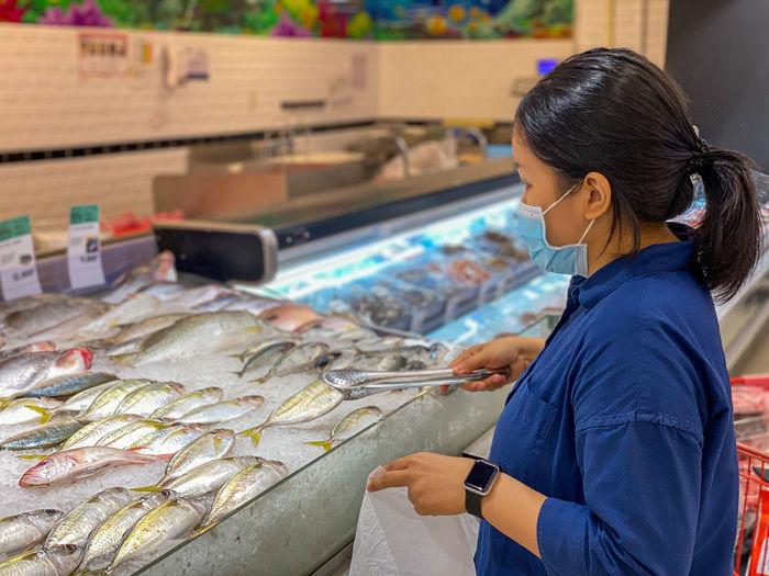 Woman working at fish market