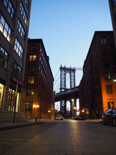 Illuminated bridge against sky at dusk